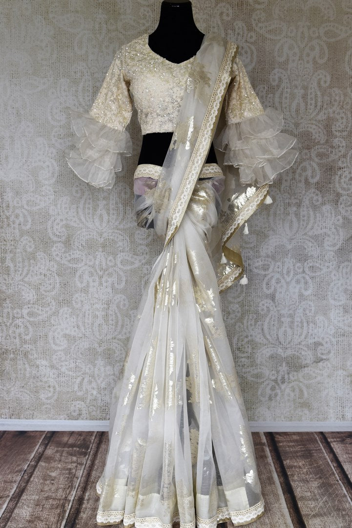 Buy off-white organza sari online in USA with knitted border and saree blouse. Make fashionable choices with latest Indian designer saris from Pure Elegance Indian fashion store in USA. Shop traditional Kanchipuram silk sarees, Banarasi sarees, bridal sarees for Indian brides in USA from our online store.-full view
