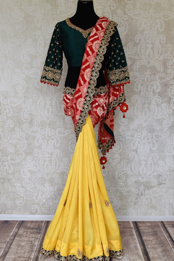 Shop yellow and red embroidered georgette Banarasi silk sari online in USA with green saree blouse. Make fashionable choices with latest Indian designer saris from Pure Elegance Indian fashion store in USA. Shop Kanchipuram silk saris, Banarasi sarees, bridal sarees for Indian brides in USA from our online store.-full view