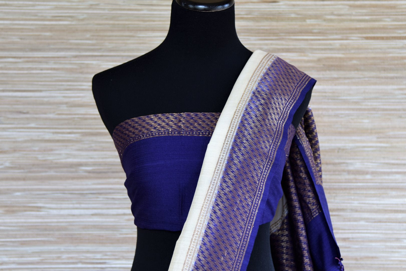 Buy white and blue muga Banarasi saree online in USA with floral zari work. Radiate traditional charm with beautiful Banarasi sarees from Pure Elegance Indian clothing store in USA. Choose from a variety of handwoven saris, Banarasi silk sarees, Banarasi georgette sarees, Banarasi tussar saris for special occasions.-blouse pallu