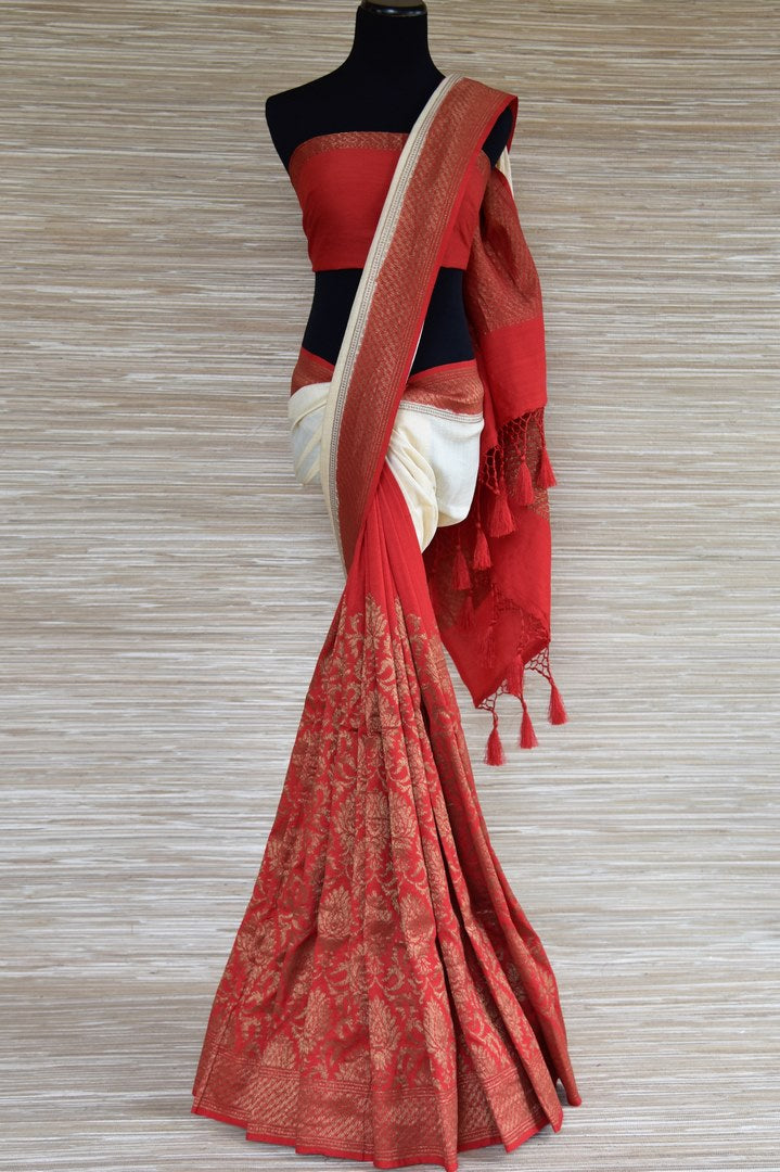 Shop white and red muga Banarasi sari online in USA with floral zari work. Radiate traditional charm with beautiful Banarasi sarees from Pure Elegance Indian clothing store in USA. Choose from a variety of handwoven saris, Banarasi silk sarees, Banarasi georgette sarees, Banarasi tussar saris for special occasions.-full view