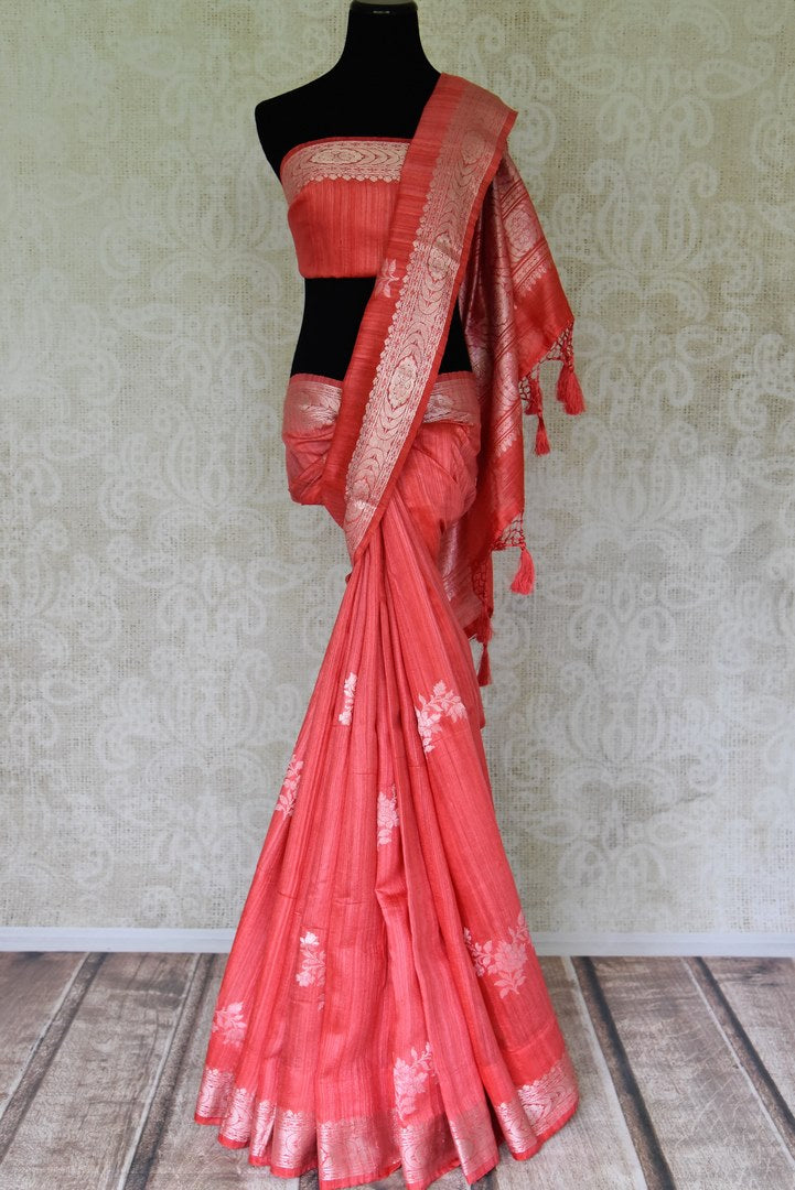 Shop coral color tussar Banarasi saree online in USA with floral zari buta and zari border. Be an epitome of elegance in exquisite Banarasi sarees from Pure Elegance Indian clothing store in USA.-full view