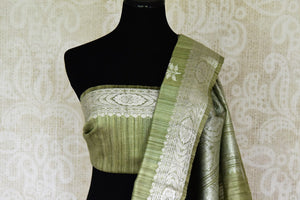 Buy pista green tussar Banarasi saree online in USA with floral zari buta and zari border. Be an epitome of elegance in exquisite Banarasi sarees from Pure Elegance Indian clothing store in USA.-blouse pallu