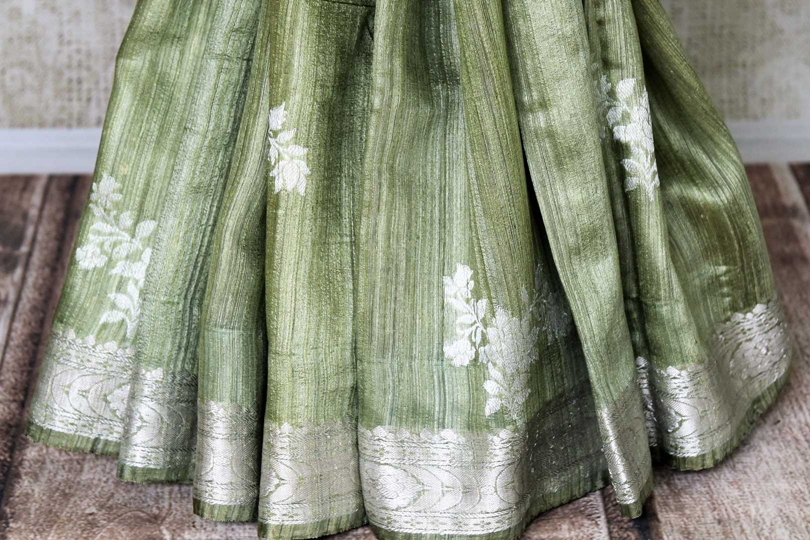 Buy pista green tussar Banarasi saree online in USA with floral zari buta and zari border. Be an epitome of elegance in exquisite Banarasi sarees from Pure Elegance Indian clothing store in USA.-pleats