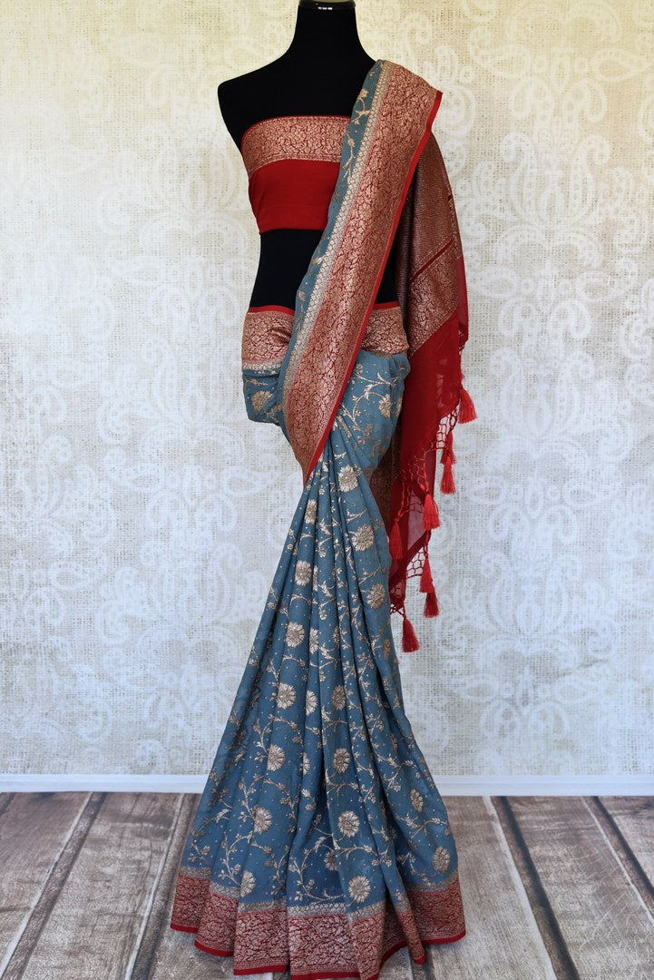 Buy blue georgette Banarasi sari online in USA with red zari border. Feel traditional on special occasions in beautiful Indian designer saris from Pure Elegance Indian fashion store in USA. Choose from a splendid variety of Banarasi sarees, pure handwoven saris. Buy online.-full view