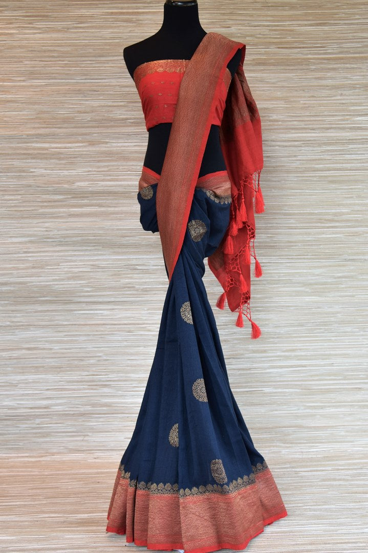 Buy navy blue muga Benarasi sari online in USA with zari buta and zari border. Radiate traditional charm with beautiful Banarasi sarees from Pure Elegance Indian clothing store in USA. Choose from a variety of handwoven saris, Banarasi silk sarees, Banarasi georgette sarees, Banarasi tussar saris for special occasions.-full view