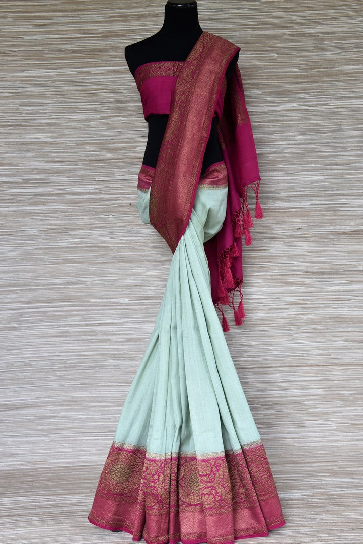 Shop mint green muga Banarasi sari online in USA with pink antique zari border. Be a vision in the beautifu Banarasi sarees from Pure Elegance Indian clothing store in USA. Shop online now.-full view