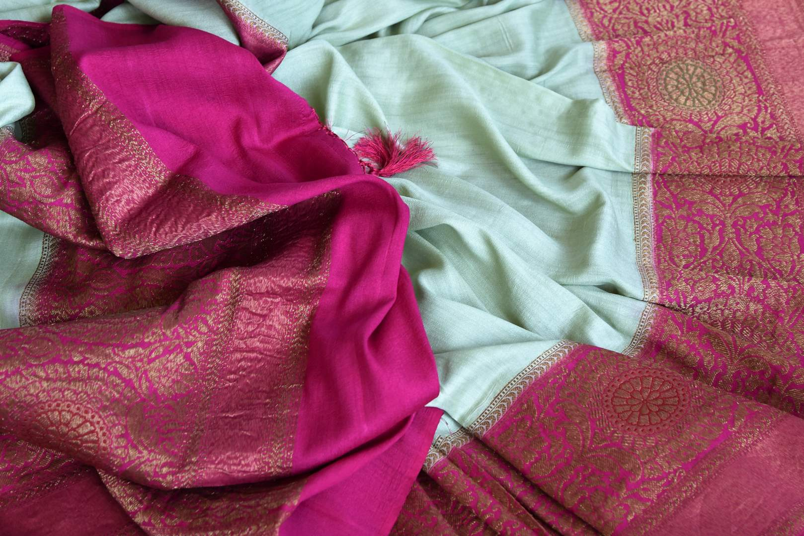 Shop mint green muga Banarasi sari online in USA with pink antique zari border. Be a vision in the beautifu Banarasi sarees from Pure Elegance Indian clothing store in USA. Shop online now.-details