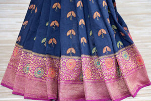 Shop navy blue muga Banarasi sari online in USA with flower minakari zari buta. Radiate traditional charm with beautiful Banarasi sarees from Pure Elegance Indian clothing store in USA. Choose from a variety of Banarasi silk sarees, Banarasi georgette sarees, Banarasi tussar saris for special occasions.-pleats
