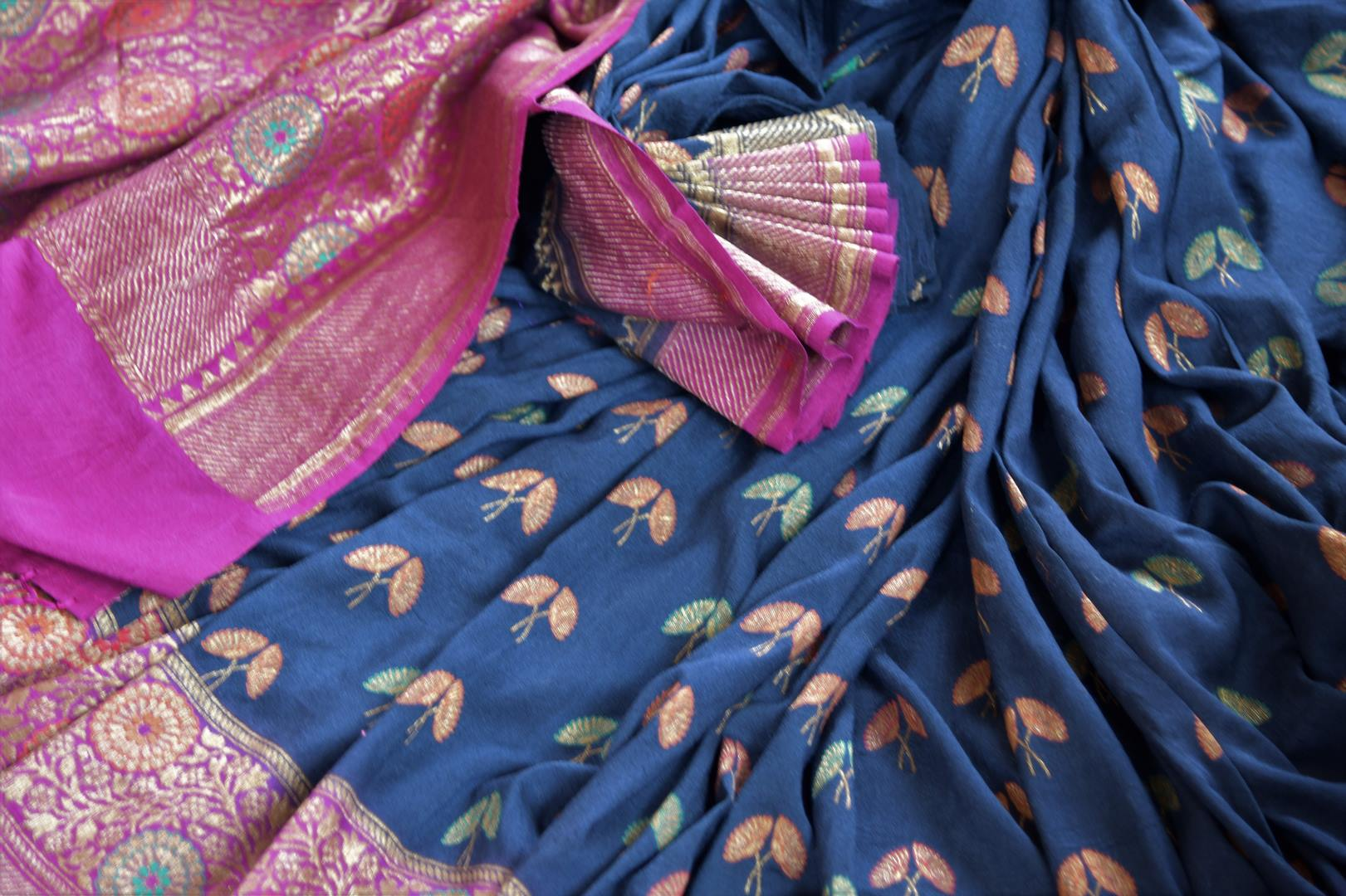 Shop navy blue muga Banarasi sari online in USA with flower minakari zari buta. Radiate traditional charm with beautiful Banarasi sarees from Pure Elegance Indian clothing store in USA. Choose from a variety of Banarasi silk sarees, Banarasi georgette sarees, Banarasi tussar saris for special occasions.-details