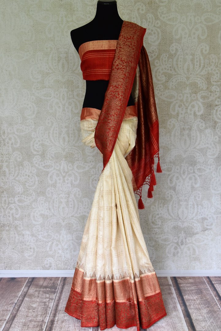 Shop off-white tussar Benarasi saree online in USA with red floral zari border. Be an epitome of elegance in exquisite Banarasi sarees from Pure Elegance Indian clothing store in USA.-full view