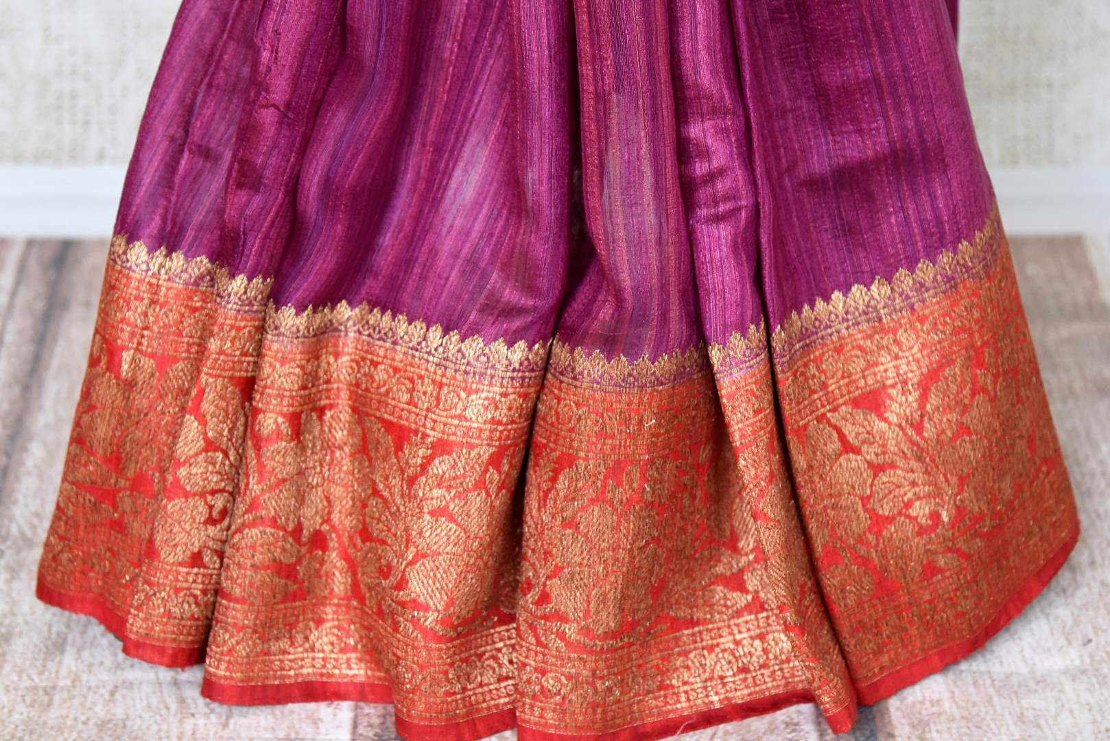 Buy purple tussar Benarasi saree online in USA with red antique zari border. Be an epitome of elegance in exquisite Banarasi saris from Pure Elegance Indian clothing store in USA.-pleats