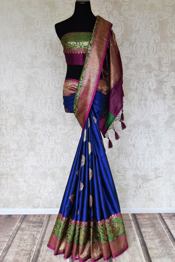 Buy blue striped tussar Benarasi saree online in USA with zari buta and purple and green antique zari border. Shine bright in best of Indian designer sarees from Pure Elegance Indian fashion store in USA on special occasions. Choose from a splendid variety of Banarasi sarees, pure handwoven saris. Shop online.-full view