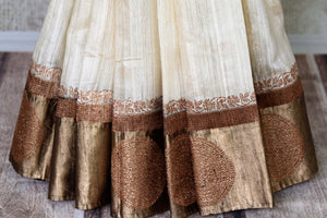 Shop off-white tussar Benarasi saree online in USA with black golden zari border. Be an epitome of elegance in exquisite Banarasi saris from Pure Elegance Indian clothing store in USA.-pleats