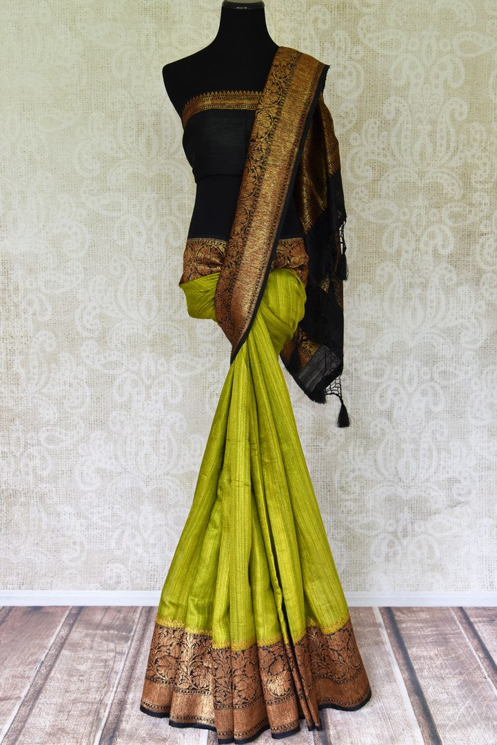Buy lime green color tussar Benarasi saree online in USA with black zari border. Be an epitome of elegance in exquisite Banarasi saris from Pure Elegance Indian clothing store in USA.-full view