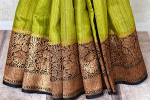 Buy lime green color tussar Benarasi saree online in USA with black zari border. Be an epitome of elegance in exquisite Banarasi saris from Pure Elegance Indian clothing store in USA.-pleats