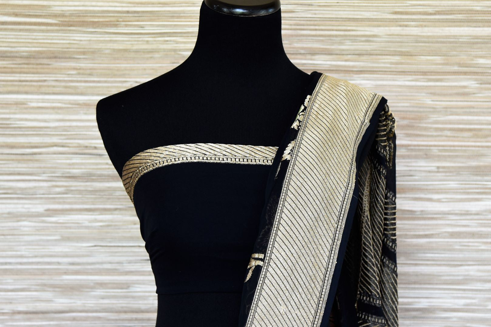 Buy midnight blue Banarasi georgette saree online in USA with flower zari buta and zari border. Make your ethnic wardrobe colorful and rich with a splendid collection of Banarasi saris from Pure Elegance Indian clothing store in USA. Shop online.-blouse pallu