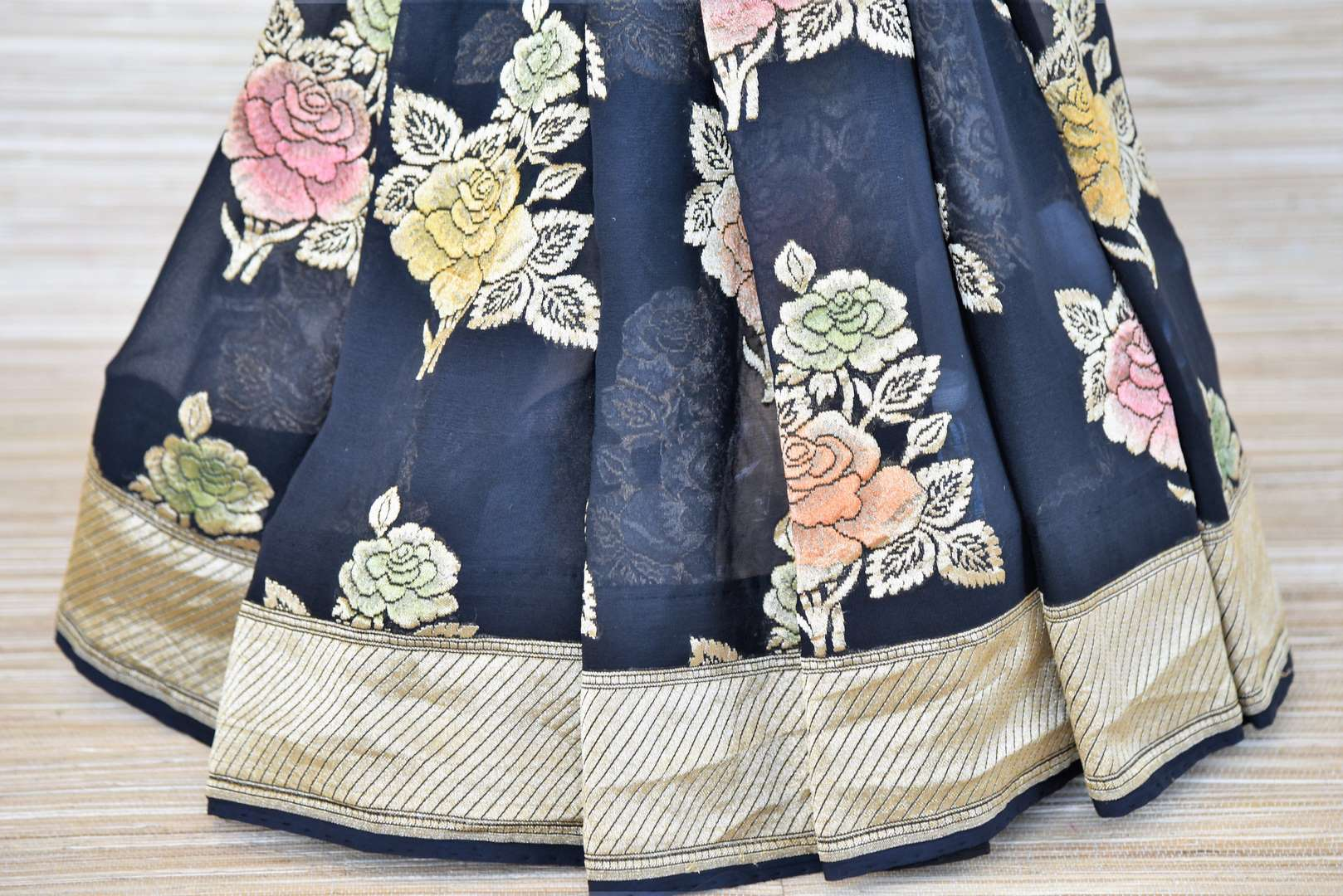 Buy midnight blue Banarasi georgette saree online in USA with flower zari buta and zari border. Make your ethnic wardrobe colorful and rich with a splendid collection of Banarasi saris from Pure Elegance Indian clothing store in USA. Shop online.-pleats