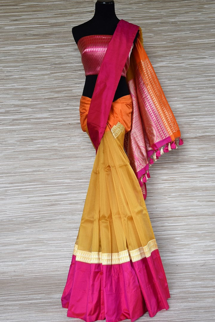 Buy mustard tissue silk Banarasi saree online in USA with pink border. Be a stunner on special occasions in exquisite Banarasi silk sarees, handwoven saris from Pure Elegance Indian fashion store in USA for Indian women.-full view