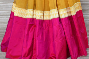 Buy mustard tissue silk Banarasi saree online in USA with pink border. Be a stunner on special occasions in exquisite Banarasi silk sarees, handwoven saris from Pure Elegance Indian fashion store in USA for Indian women.-pleats