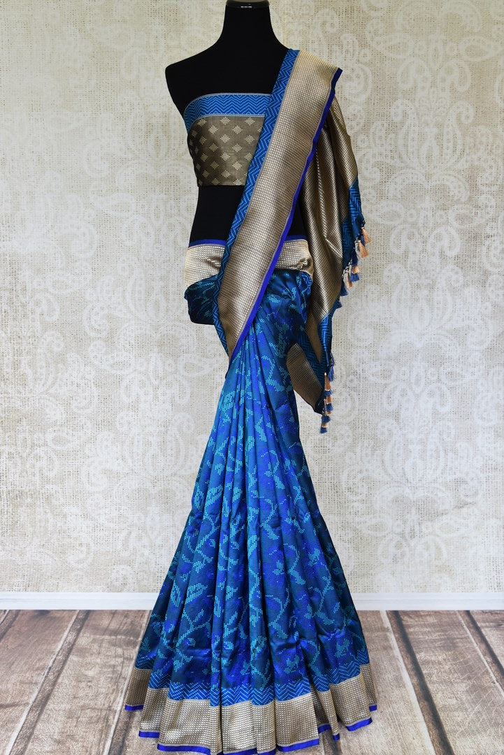 Buy blue Banarasi silk saree online in USA with woven floral design and zari border. Relive tradition in Indian Banarasi sarees from Pure Elegance Indian clothing store in USA. Enhance your ethnic look with pure silk sarees, Kanchipuram sarees, handloom sarees available online.-full view