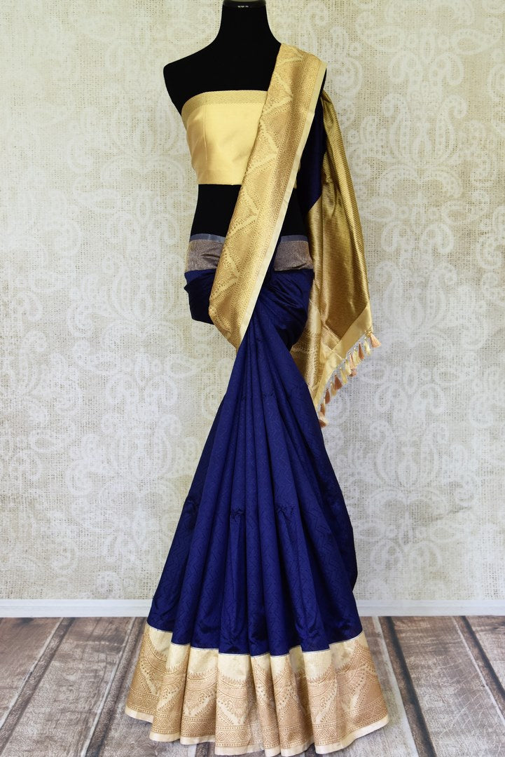 Shop navy blue Banarasi silk sari online in USA with golden zari border. Shine bright on weddings and special occasions with beautiful Indian sarees, Banarasi silk saris, pure silk sarees from Pure Elegance Indian fashion store in USA.-full view