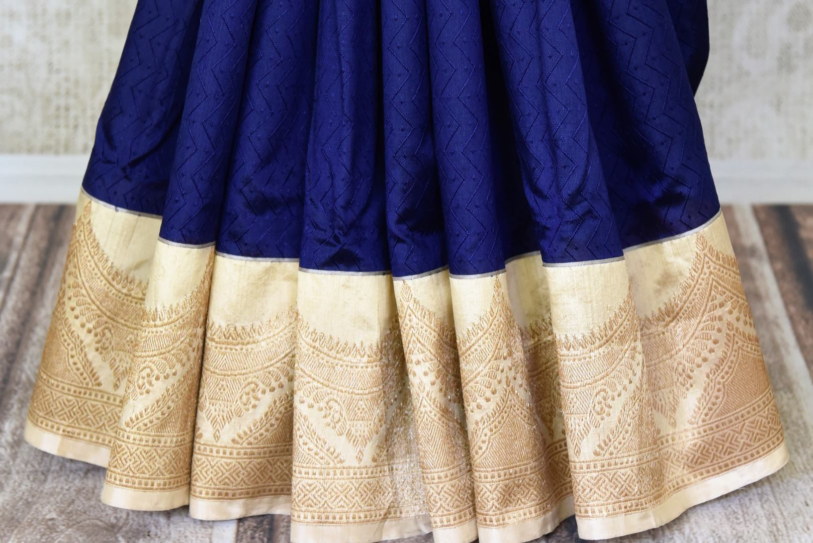 Shop navy blue Banarasi silk sari online in USA with golden zari border. Shine bright on weddings and special occasions with beautiful Indian sarees, Banarasi silk saris, pure silk sarees from Pure Elegance Indian fashion store in USA.-pleats