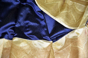 Shop navy blue Banarasi silk sari online in USA with golden zari border. Shine bright on weddings and special occasions with beautiful Indian sarees, Banarasi silk saris, pure silk sarees from Pure Elegance Indian fashion store in USA.-details