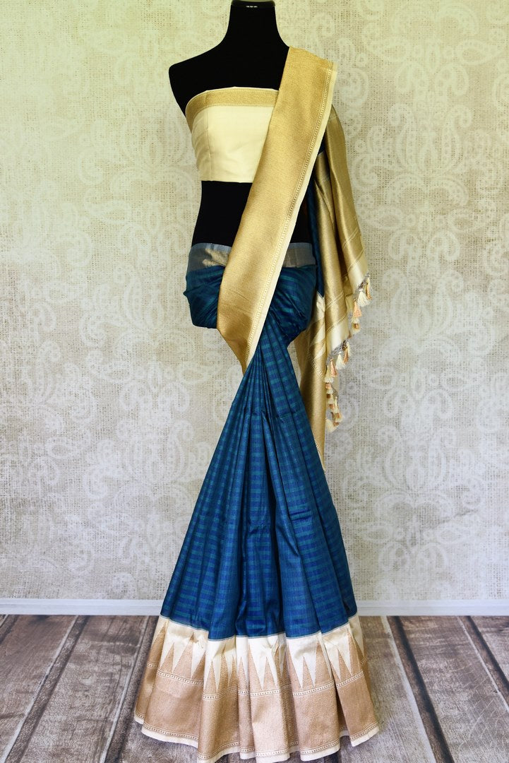 Buy elegant blue striped tussar Banarasi saree online in USA with golden zari border and pallu. Take your ethnic style  to next level with exquisite Banarasi saris from Pure Elegance Indian fashion store in USA. Shop online.-full view