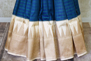 Buy elegant blue striped tussar Banarasi saree online in USA with golden zari border and pallu. Take your ethnic style  to next level with exquisite Banarasi saris from Pure Elegance Indian fashion store in USA. Shop online.-pleats