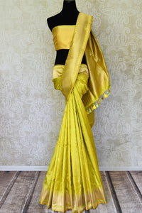 Shop yellow Benarasi silk saree online in USA with golden zari border. Shine bright on weddings and special occasions with beautiful Indian sarees, Banarasi silk saris, pure silk sarees from Pure Elegance Indian fashion store in USA.-full view