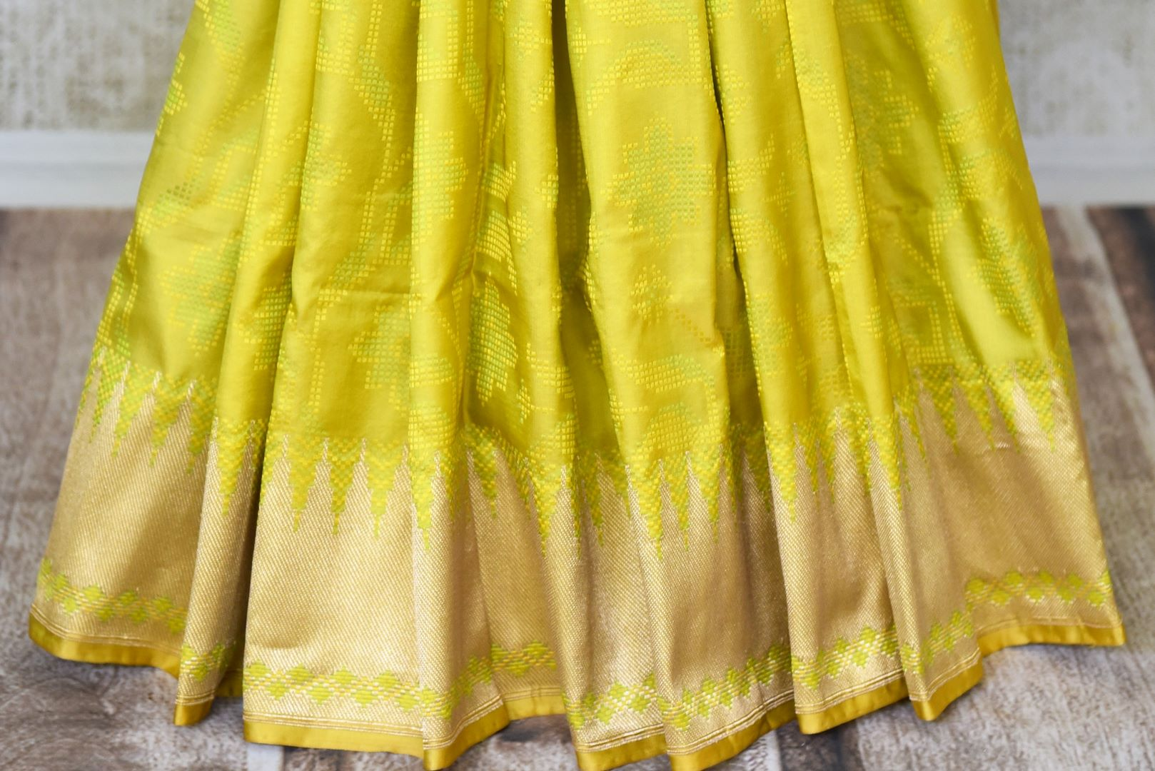 Shop yellow Benarasi silk saree online in USA with golden zari border. Shine bright on weddings and special occasions with beautiful Indian sarees, Banarasi silk saris, pure silk sarees from Pure Elegance Indian fashion store in USA.-pleats