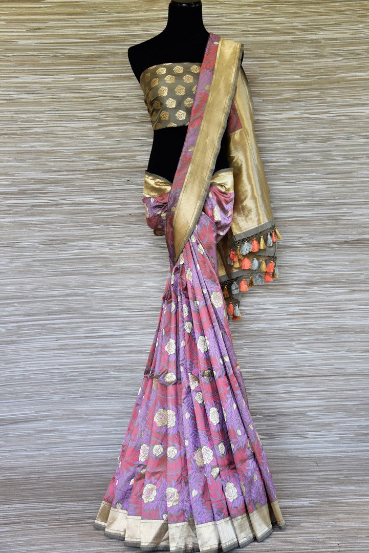 Shop stunning violet floral Banarasi silk saree online in USA with zari border. Be the highlight of weddings and special occasions with your stunning Indian look in exquisite handwoven sarees from Pure Elegance Indian fashion store in USA. Shop online now.-full view