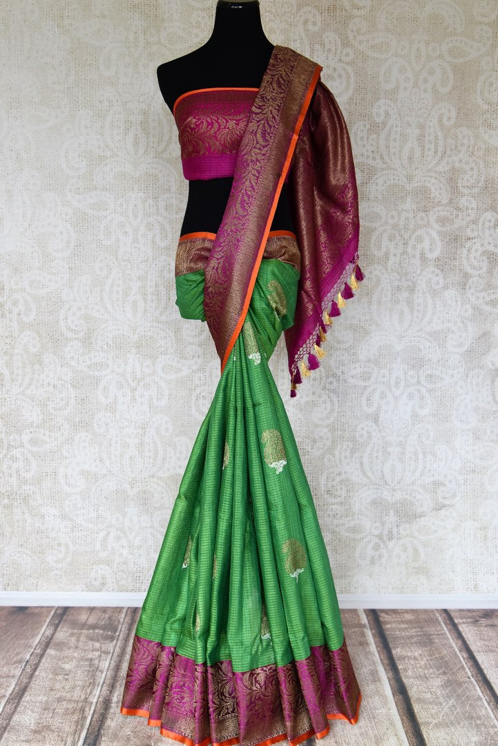 Shop light green striped tussar Benarasi sari online in USA with zari buta and purple antique zari border. Shine bright in best of Indian designer sarees from Pure Elegance Indian fashion store in USA on special occasions. Choose from a splendid variety of Banarasi sarees, pure handwoven saris. Shop online.-full view