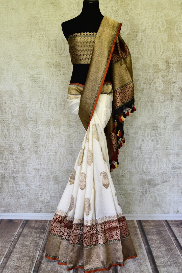Shop off-white linen Banarasi saree online in USA with heavy zari border. Channel your inner Indian diva with a range exquisite traditional Banarasi saris from Pure Elegance Indian fashion store in USA. Shop now.-full view