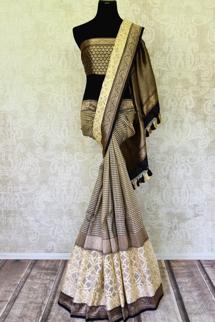 Shop grey striped tussar silk saree online in USA with cream jaal and zari border. Take your ethnic style  to next level with exquisite handwoven silk saris from Pure Elegance Indian fashion store in USA. Shop online.-full view