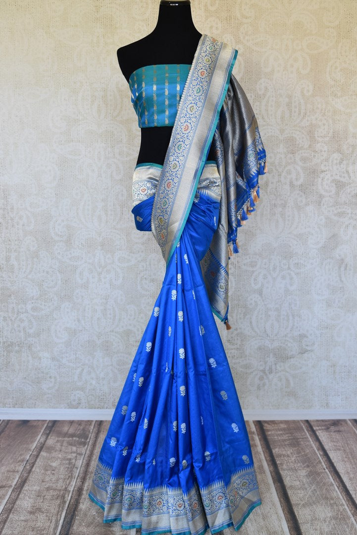 Buy blue Banarasi silk sari online in USA with flower buta and zari minakari border. Raise your ethnic style quotient at weddings and special occasions with exquisite Indian sarees from Pure Elegance Indian clothing store in USA. Pick from a tasteful collection of handloom sarees, pure silk sarees, Banarasi saris. Shop now.-full view