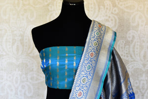 Buy blue Banarasi silk sari online in USA with flower buta and zari minakari border. Raise your ethnic style quotient at weddings and special occasions with exquisite Indian sarees from Pure Elegance Indian clothing store in USA. Pick from a tasteful collection of handloom sarees, pure silk sarees, Banarasi saris. Shop now.-blouse pallu
