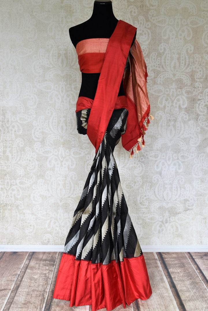 Shop black Banarasi silk saree online in USA with red border and pallu. Radiate traditional charm with beautiful Banarasi saris from Pure Elegance Indian clothing store in USA. Choose from a variety of Banarasi silk sarees, Banarasi georgette saris, Banarasi tussar sarees for special occasions.-full view