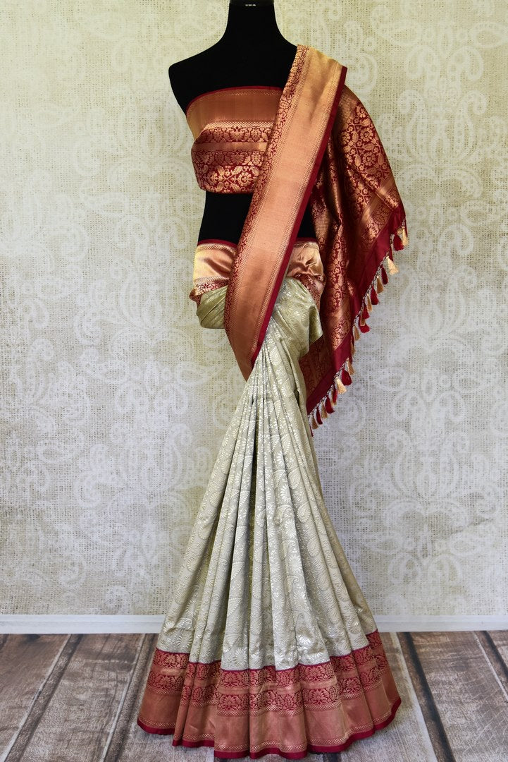 Buy beautiful grey heavy zari work Benarasi silk saree online in USA with red zari border. Shine bright on weddings and special occasions with beautiful Indian saris, Banarasi silk sarees, pure silk sarees from Pure Elegance Indian fashion store in USA.-full view