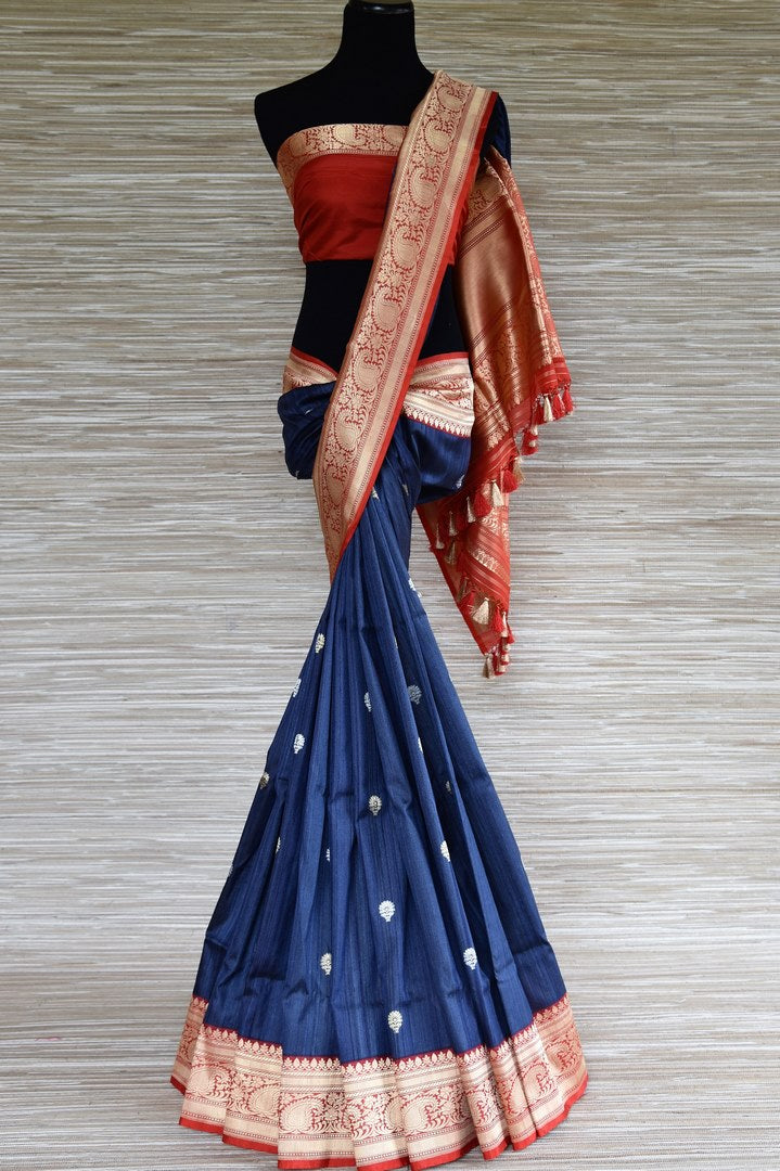 Buy dark blue Banarasi silk saree online in USA with red zari border and zari buta. Enhance your traditional saree look with a splendid range of designer saris from Pure Elegance Indian fashion store in USA.-full view