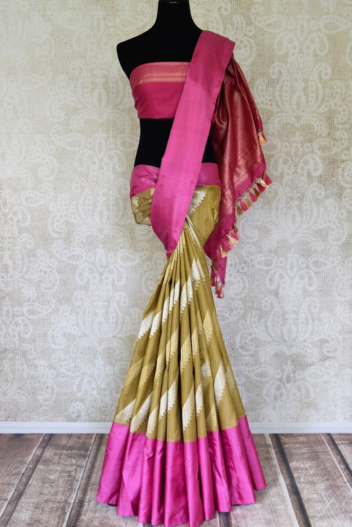 Shop gorgeous olive green linen Banarasi saree online in USA with solid pink border. Be the talk of weddings and other special occasions with your striking look in stunning Banarasi silk sarees, handloom sarees from Pure Elegance Indian fashion store in USA.-full view