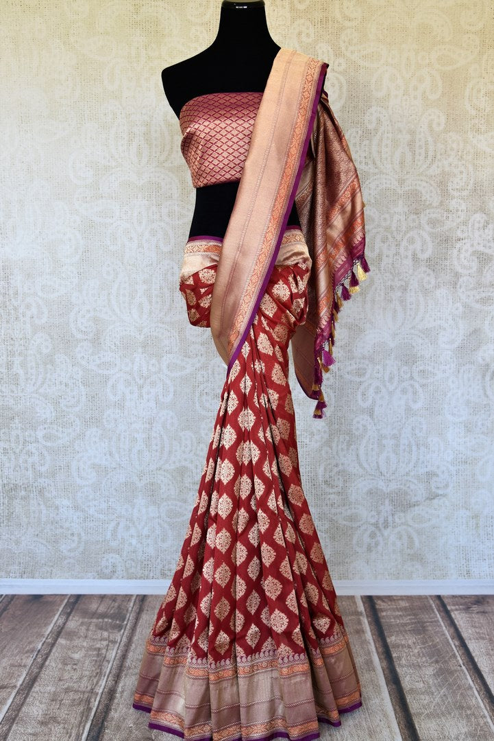 Shop maroon Banarasi silk sari online in USA with zari buta and zari border. Raise your ethnic style quotient at weddings and special occasions with exquisite Indian sarees from Pure Elegance Indian clothing store in USA. Pick from a tasteful collection of handloom sarees, pure silk sarees, Banarasi saris. Shop now.-full view
