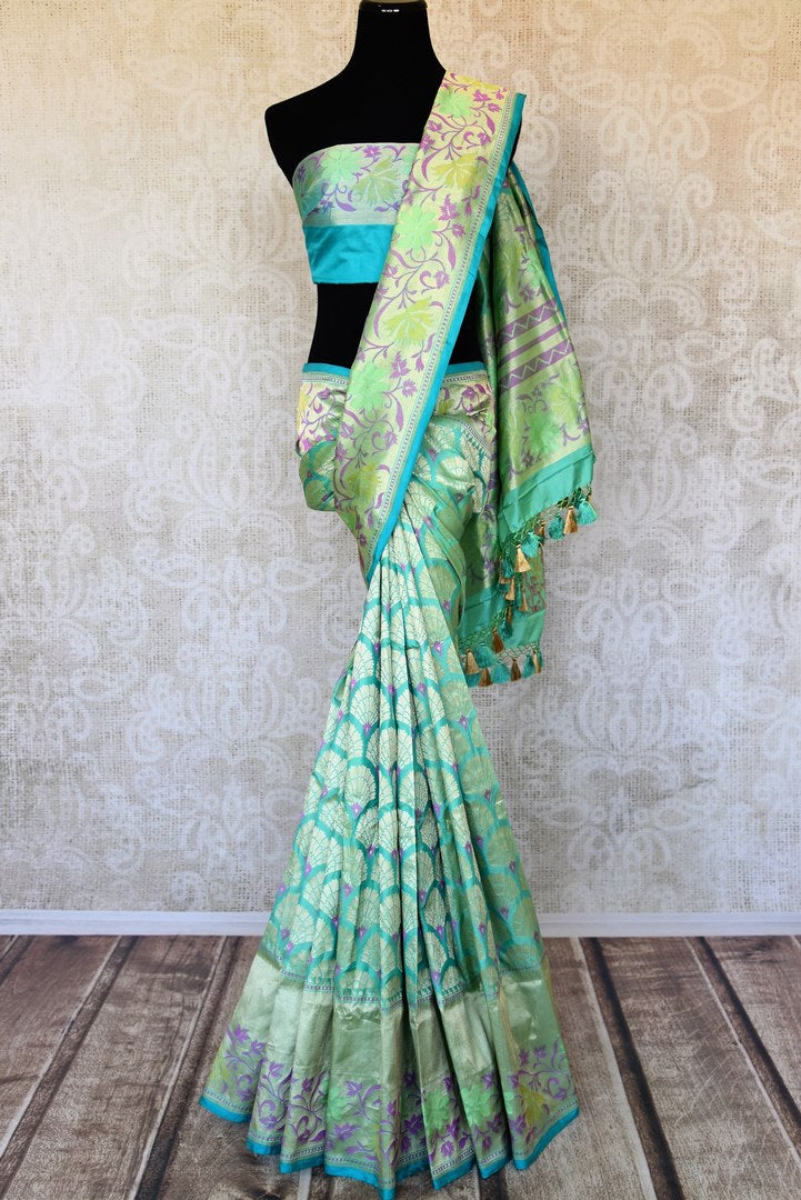 Shop sea blue Banarasi silk saree online in USA with flower zari buta and zari minakari border. Feel traditional on special occasions in beautiful Indian designer sarees from Pure Elegance Indian fashion store in USA. Choose from a splendid variety of Banarasi sarees, pure handwoven saris. Buy online.-full view