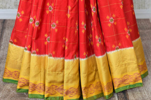 Shop red ikkat silk saree online in USA with yellow zari border. Relive tradition in Indian Banarasi sarees from Pure Elegance Indian clothing store in USA. Enhance your ethnic look with pure silk sarees, Kanchipuram sarees, handloom sarees available online.-pleats