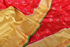 Shop red ikkat silk saree online in USA with yellow zari border. Relive tradition in Indian Banarasi sarees from Pure Elegance Indian clothing store in USA. Enhance your ethnic look with pure silk sarees, Kanchipuram sarees, handloom sarees available online.-details