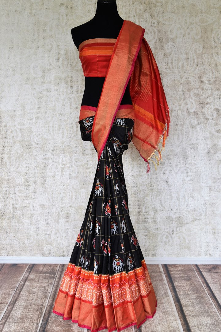 Shop black check ikkat silk saree online in USA with orange ikkat zari border. Relive tradition in Indian Banarasi sarees from Pure Elegance Indian clothing store in USA. Enhance your ethnic look with pure silk sarees, Kanchipuram sarees, handloom sarees available online.-full view