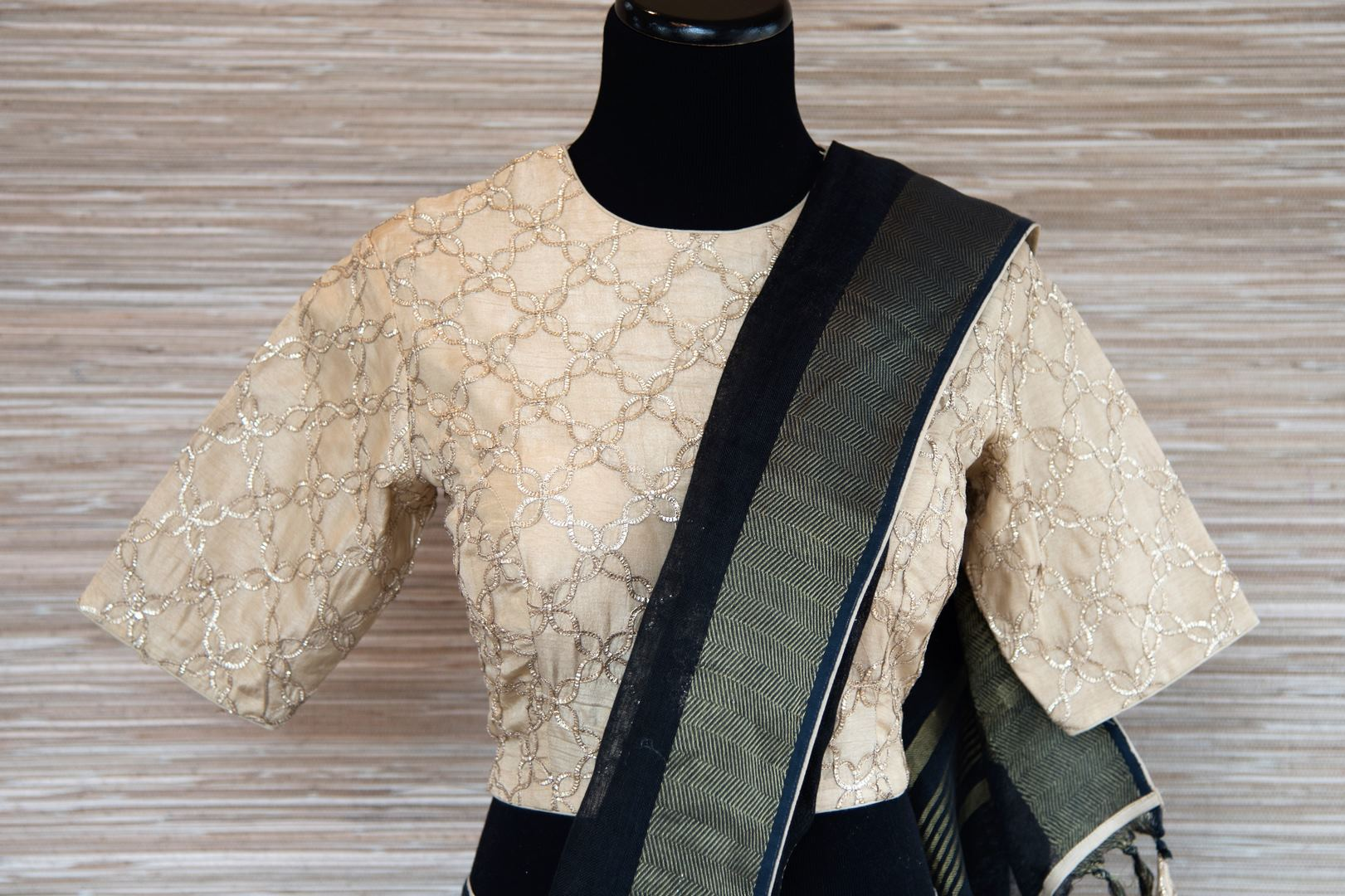 Shop black linen saree online in USA with zari border and bird nest motifs. Make your ethnic style even more stylish with an exclusive range on Indian handloom sarees from Pure Elegance Indian fashion store in USA. -blouse pallu