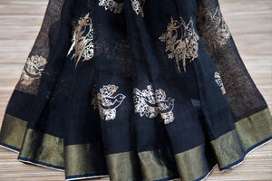 Shop black linen saree online in USA with zari border and bird nest motifs. Make your ethnic style even more stylish with an exclusive range on Indian handloom sarees from Pure Elegance Indian fashion store in USA. -pleats