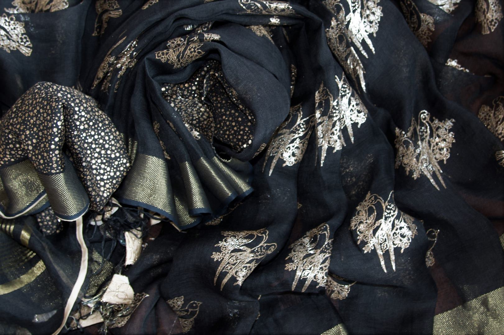 Shop black linen saree online in USA with zari border and bird nest motifs. Make your ethnic style even more stylish with an exclusive range on Indian handloom sarees from Pure Elegance Indian fashion store in USA. -details