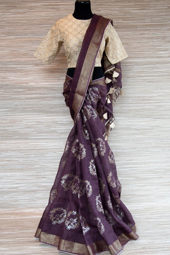 Buy purple linen saree online in USA with zari border and bird nest motifs. Make your ethnic style even more stylish with an exclusive range on Indian handloom sarees from Pure Elegance Indian fashion store in USA. -full view